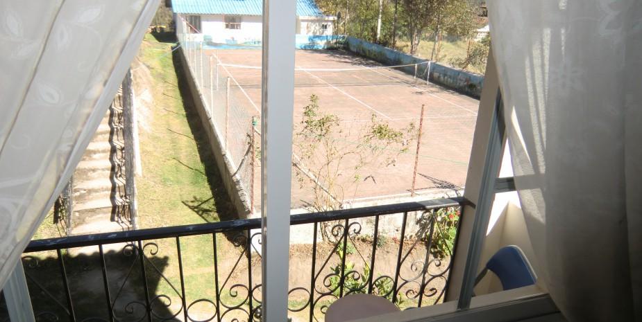 View of tennis court from Imbabura 2 bedroom